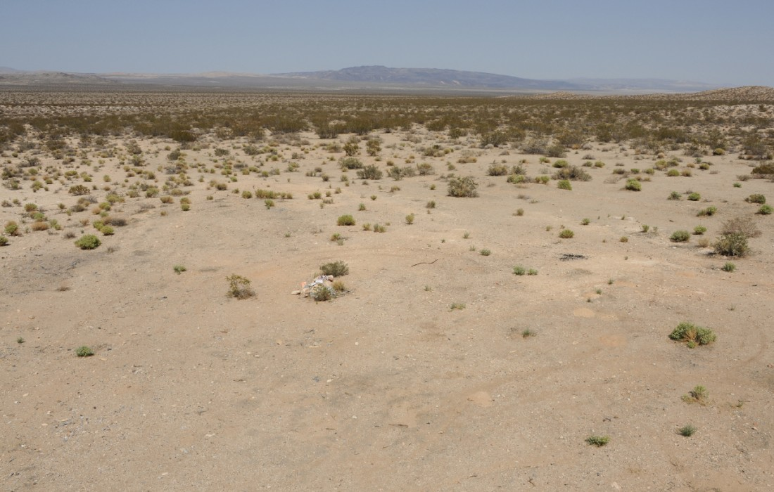 Crash sites are usually remote, and sometimes have an area that is noticeably bare, like this one, near Harper Dry Lake, west of Barstow, California, where a supersonic B-1 bomber prototype crashed in 1984. CLUI photo, 2012.