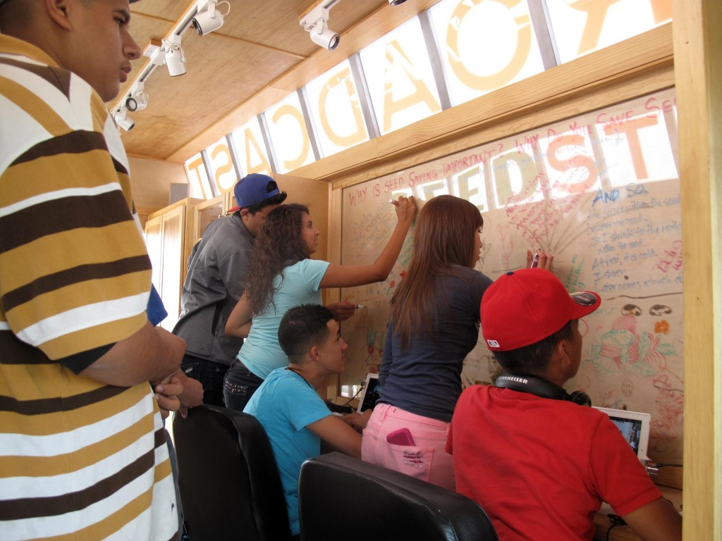 Students from South Valley Academy, share ideas and drawings inside the Mobile Seed Story Broadcasting Station. Albuquerque, NM, Sept 2012.