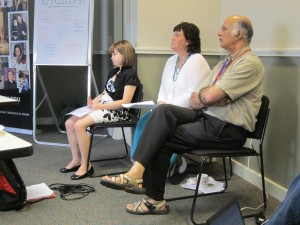Cynthia Sauer and her daughter Sarah sit with Arjun at the July 2012 workshop. Sarah had a cancerous brain tumor removed in 2001, diagnosed when she was seven years old.