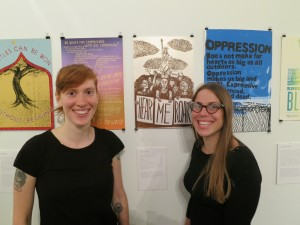 """Interference Archive organizer Molly Fair (left) with artist Meredith Stern (right) at the exhibit """"This is an Emergency"""""""
